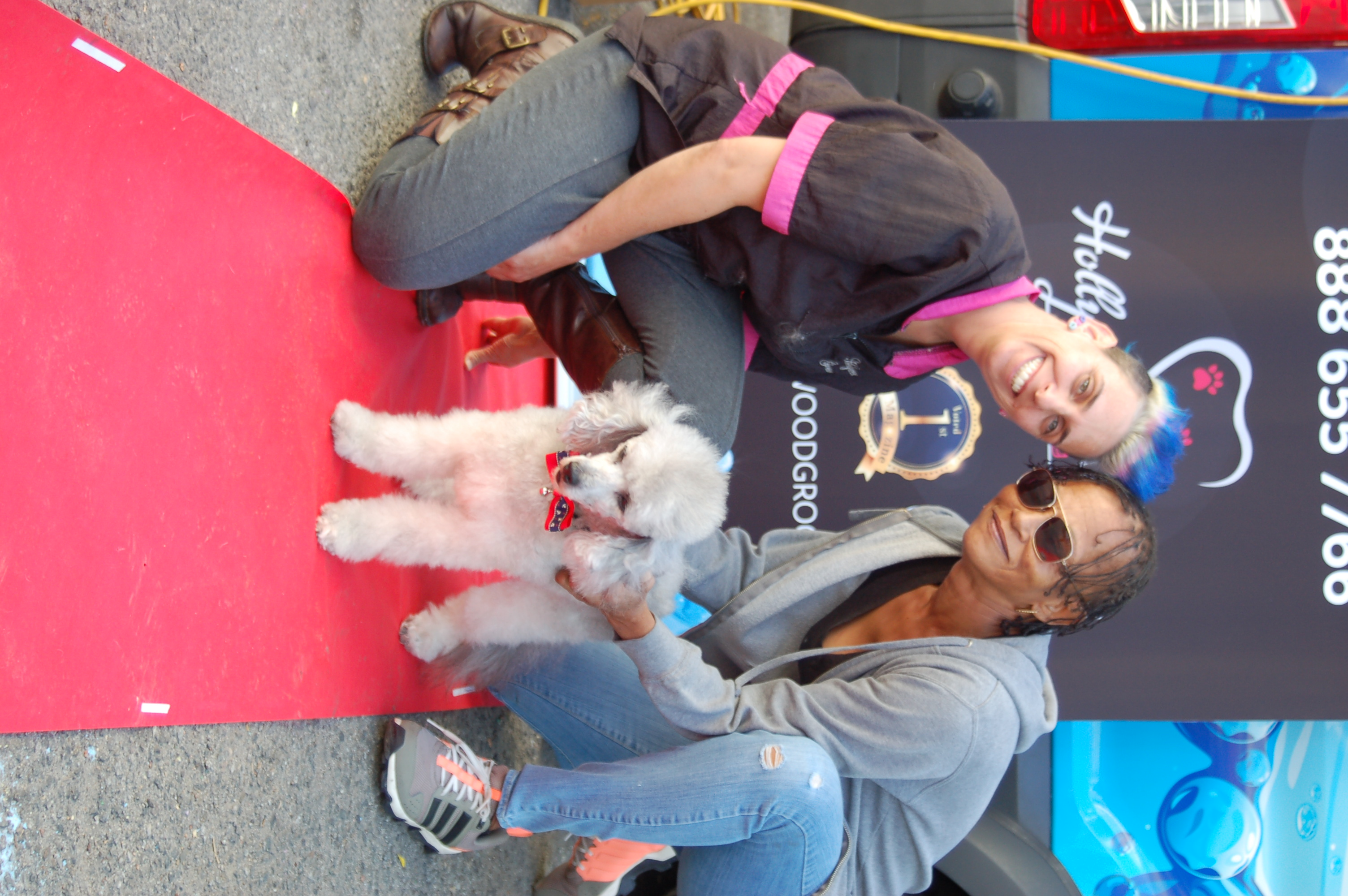 Yael and a pet owner on the red carpet at a Community Event.