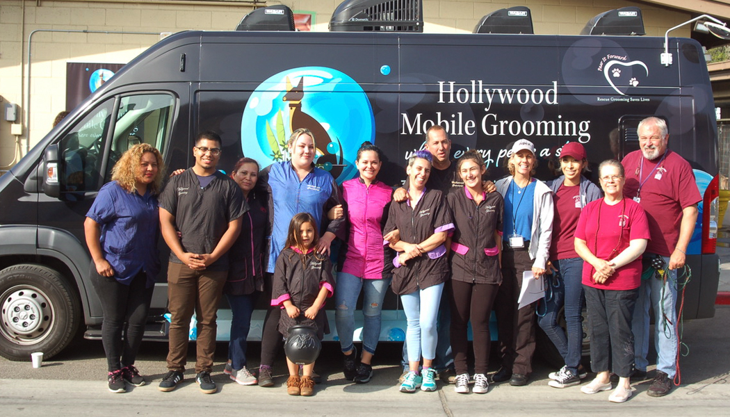 Hollywood Mobile Grooming team in front of the van.